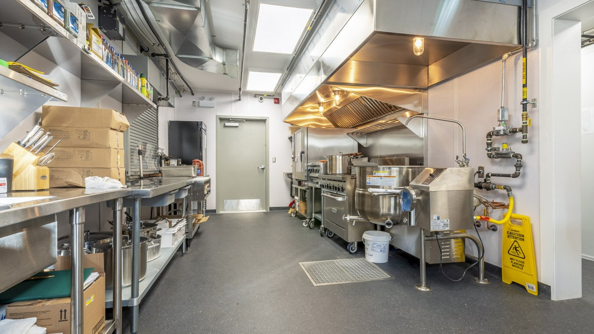A full equipped commercial kitchen for on-site camp infrastructure.